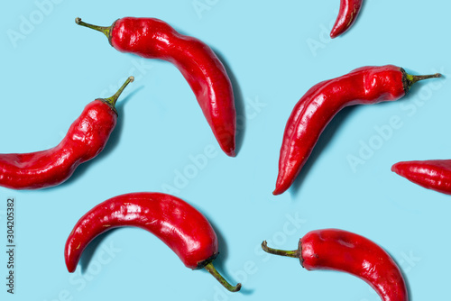 Top view of fresh chilli pepper isolated on blue background Canvas Print