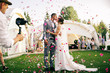 canvas print picture - photographer shoots couple in rose petals