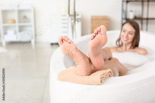 Beautiful young woman relaxing in bathtub Canvas Print