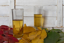 Glasses With Brandy On The Background Of Autumn Leaves
