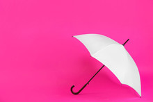 Beautiful White Umbrella On Pink Background. Space For Text
