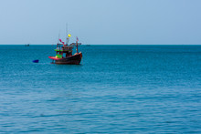 A Small Fishing Boat Anchored ...