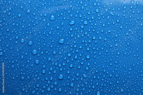 Water drops on blue background, top view - 304245900