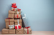 canvas print picture - pile of wrapped christmas gifts on blue background