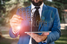 Writing Note Showing Seek The Truth. Business Concept For Looking For The Real Facts Investigate Study Discover Businessman In Blue Suite Stands With Mobile Phone In Hands