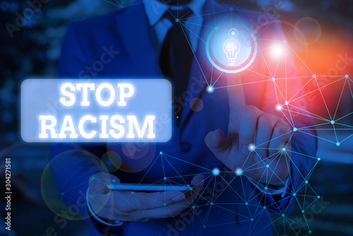 Photo Text sign showing Stop Racism