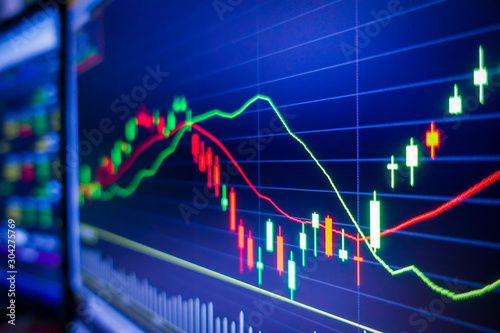 Blue stock exchange market graph on LED screen for business analysis. Finance and economic graphs.