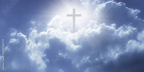 Fototapeta  Christian cross appeared bright in the sky with soft fluffy clouds, white, beautiful colors