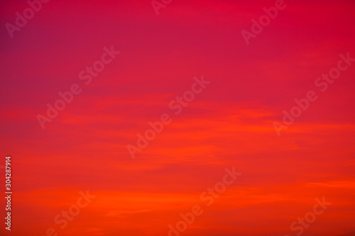 Foto op Canvas Rood The background view of the sky is close, with various colors changing according to the weather (orange, red, yellow, pink, blue) is a natural beauty.