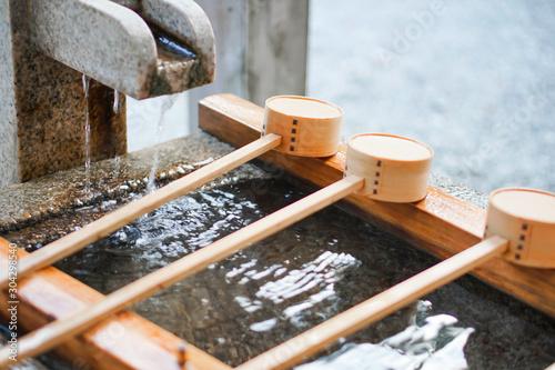 Fotografie, Obraz 手水舎 Hand water house Temizusya, Shinto shrine, Japan.