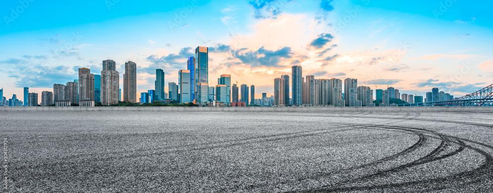 Fototapeta Sunset empty asphalt road and city skyline in Chongqing