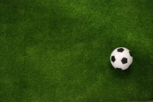 Soccer Ball On The Green Field. View From Above. Flat Lay.Copy Space.