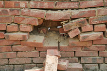 Large Hole In The Brick Wall