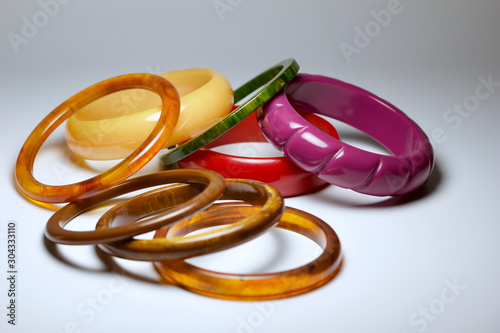 Close up view of vintage bakelite bangle bracelets in varying colors and widths Wallpaper Mural