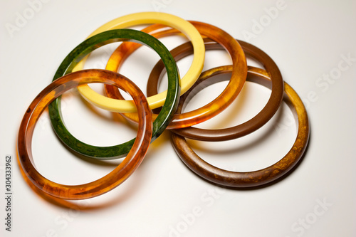 Close up view of vintage bakelite bangle bracelets in varying colors and widths Canvas Print