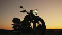 Silhouette At Sunset Of A Moto...