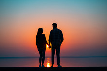 The Couple Against The Beautiful Sunset
