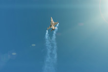 F-16 Fighting Military Fighter Jet Airplane Flying With Smoke Against Blue Sky Background.