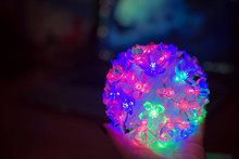 Glowing Christmas Ball On A Black Background