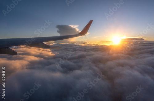 Clouds and sky as seen through window of an aircraft Wallpaper Mural