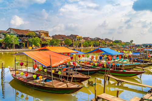 Leinwand Poster  Wooden boats on the Thu Bon River in Hoi An , Vietnam