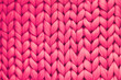 canvas print picture - Texture of pink wool big knit blanket. Large knitting. Plaid merino wool. Top view