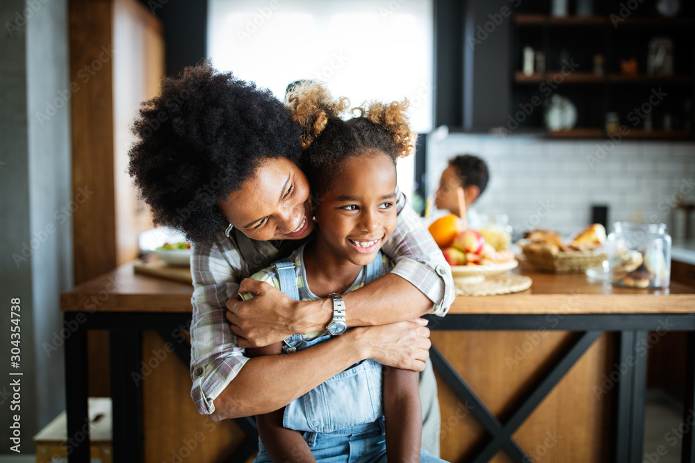 Fototapeta Happy mother and children in the kitchen. Healthy food, family, cooking concept