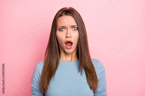Photo of fearful mad grimacing girl afraid of news she heard emotional isolated over pastel color background
