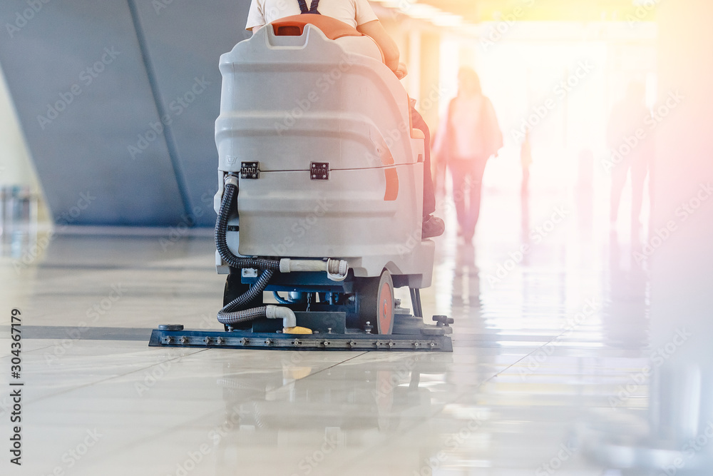 Fototapeta Close-up sweeper machine cleaning. Concept clean airport from debris
