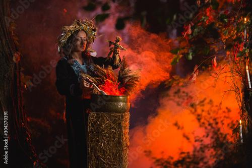 Woman sitting in burning pentagram circle, magic. Canvas Print