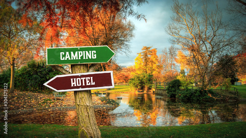 Fotografie, Obraz Street Sign to Camping versus Hotel
