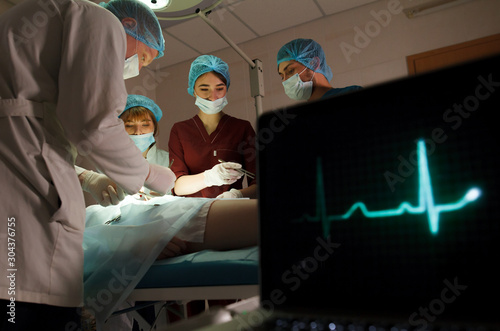 a group of surgeons doing operations in a hospital. Canvas Print