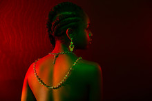 Colorful And Creative Portrait Of Pensive African Womans Back With Dark Skin