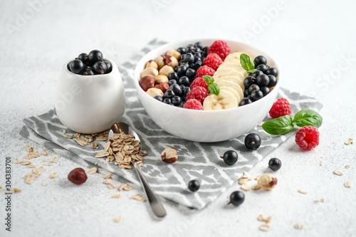 Photo .Oatmeal with berries and fruits on a light background. Healthy breakfast.