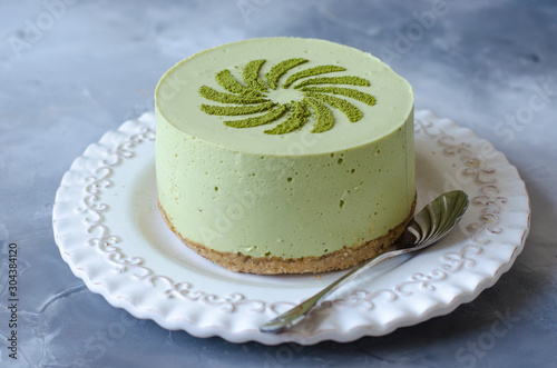 Cheesecake without baking with matcha tea on a white plate Canvas Print