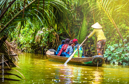 Fototapeta Tourist enjoying Mekong delta cruise with canoe on Vietnam obraz