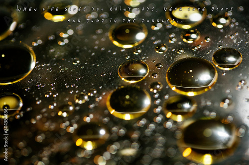 Text quote about rainy days in golden oil bubbles macro background with bokeh fi Canvas Print