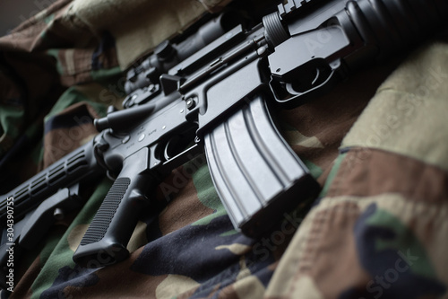 Army carbine on camouflage uniform Wallpaper Mural