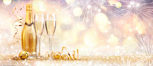 New Year Celebration With Champagne And Fireworks - Golden Abstract Background