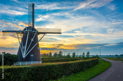 Old dutch windmill by the sunset in Etten-Leur, North Brabant