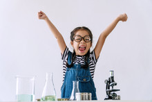 Little 6s Cute Girl Wear Glasses Happy Raise Arms With Microscope, Laboratory Bottle And Water Experiment Study Scientists While Learning Success At School. Education Science Concept.