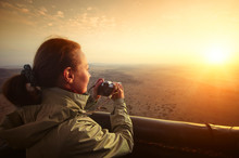 Woman Travels With Camera Flies In Balloon Over African Savannah And Watches Sunrise
