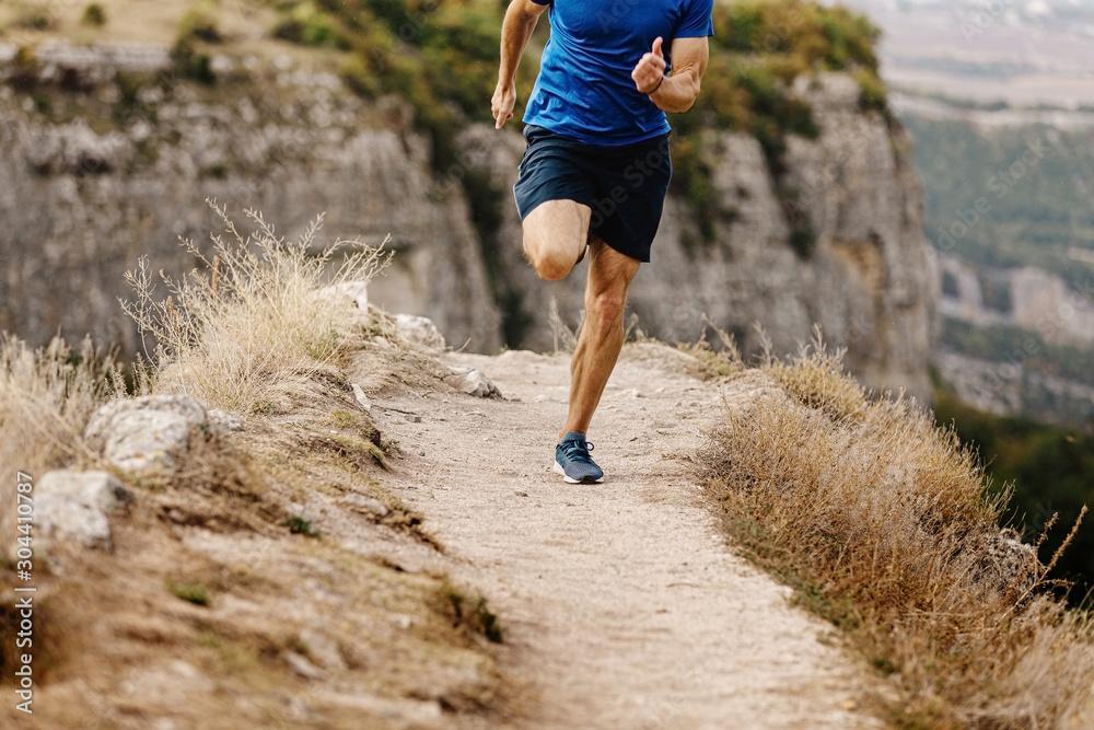 Fototapety, obrazy: athlete runner running mountain trail on edge of cliff