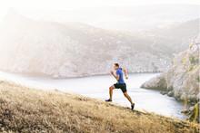 Man Athlete Running Uphill On ...