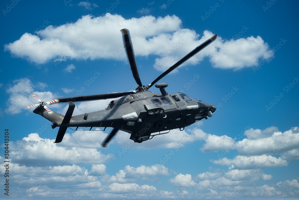 Fototapeta Military helicopter at low altitude
