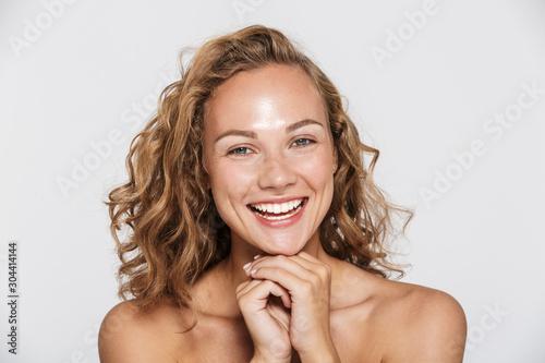Obraz na płótnie Image of happy half-naked woman laughing and looking at camera