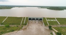 Aerial View, Filled Up Water Reservoir - Water Releasing From Dam Gateways - Flood Water Releasing Out Of The Reservoir Due To Heavy Rain.