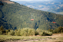 Side View Of Red Chairlift Rid...