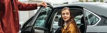 Taxi Driver Opening Car Door For Smiling Woman, Panoramic Shot