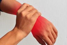 Wrist Pain. Male Holding Hand To Spot Of Wrist Pain
